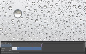 After you move the static image layer on the layers panel a new layer appears on the Timeline The static frame chosen as a photograph is now above the video