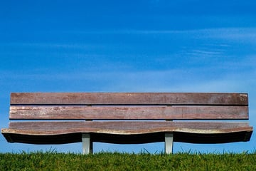 A park bench can be a theme for a project but it is also a place to sit down and wait for photography to happen