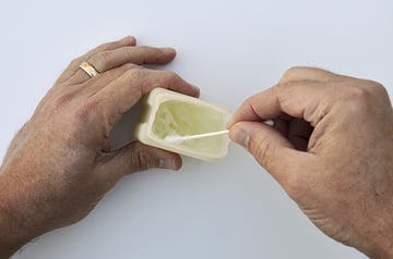 Dip the cotton swab into the petroleum jelly