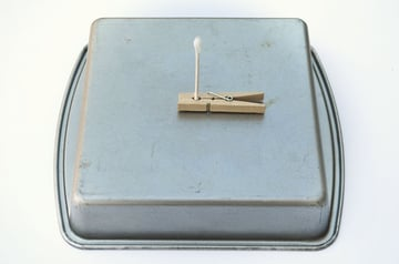 Place on a fireproof surface like an inverted cake pan