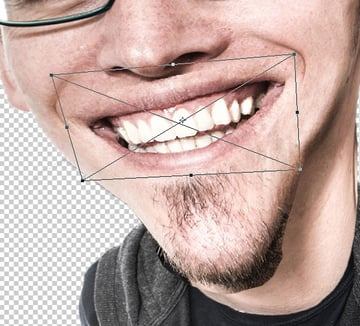 Stretch the mouth into a larger grin