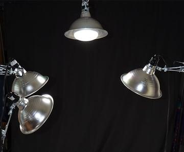 three 23 Watt CFL bulbs and one 50 Watt flood light bulb