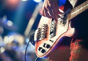 bass guitar being played
