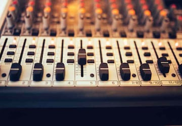 Faders on a audio control console