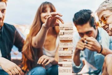 young people playing jenga