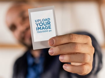 Man Holding Polaroid Photo Template PNG
