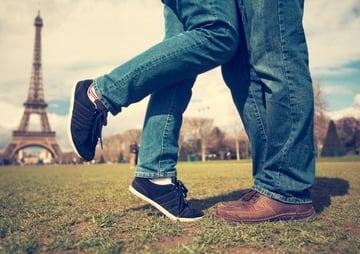Feet of couple kissing near Eiffel tower
