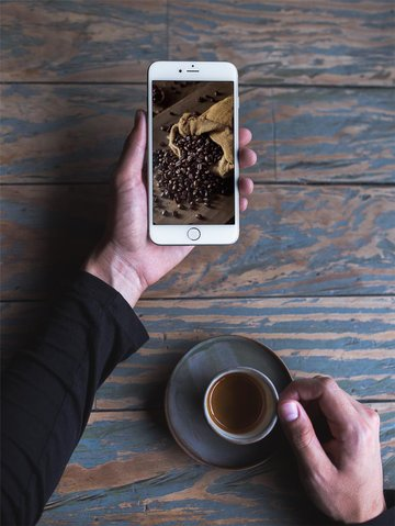 Man Holding a iPhone Mockup Template