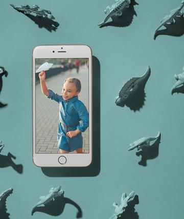 iPhone Mockup on Dinosaur Background