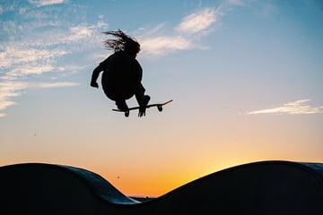 Skater catching air at sunset