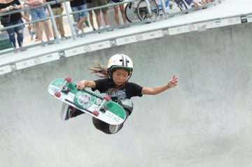 Young skater in a bowl