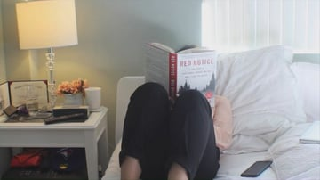Reading a book in bed