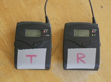 A pair of Sennheiser G3 EW100 transmitter and receiver
