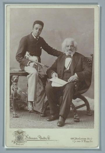 Cabinet card photograph of Frederick Douglass with his grandson Joseph Douglass