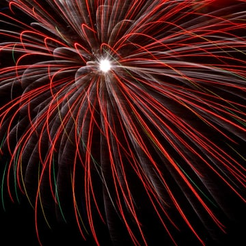 droopy red fireworks in the night sky