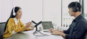 Woman gesturing during radio interview