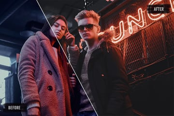 """Two young people stand in from of a sclosed shop gate, lit by neon signage that spells """"uno"""""""