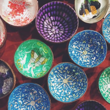 Brightly coloured bowls on a fabric-covered table