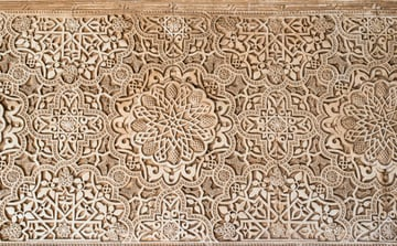 intricately carved stone wall ornamentation