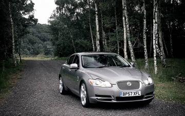 Luxury car on rural road