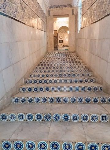 Leading lines stairway to door