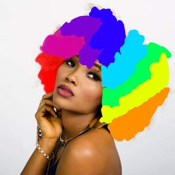 Wide stripes of eight contiguous colours painted over models hair