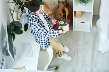 Thinking man working with color choice in office