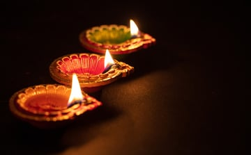 Happy Diwali Diya colorful oil lamps dark background