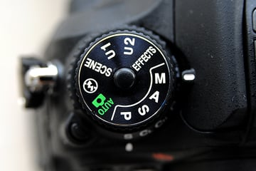 exposure mode dial on a Nikon D7100 clearly showing the M A S and P exposure modes