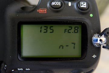 focal length and aperture information for a Nikkor AIS 135mm f28 prime lens