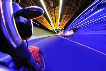 Image of motorbike in tunnel with motion blur