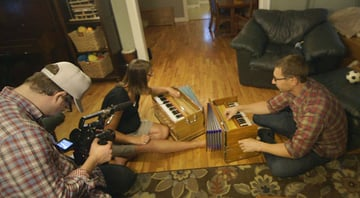 Musicians jamming in a living room