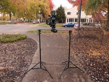 Video camera and slider on light stands