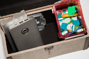 Box with external hard drives USB flash drives and tags