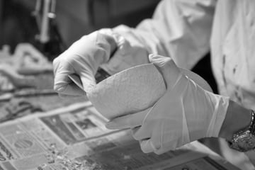 Hands of an unidentified person working on an unidentified craft