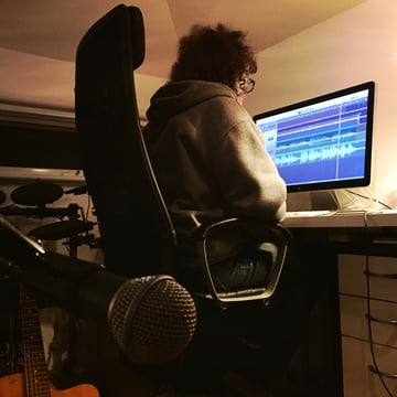 Cameron working on a recording project on his MacBook Air