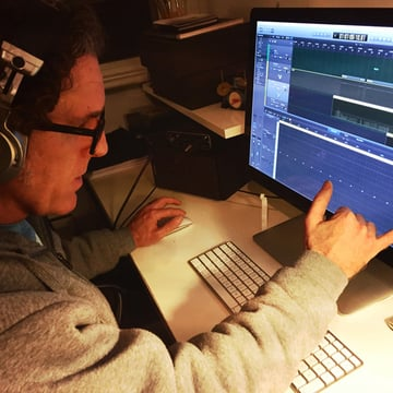 Cameron doing some audio editing on the computer