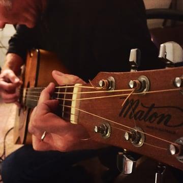 Closeup of Mark playing guitar