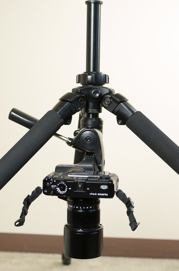 Camera on tripod with inverted center column