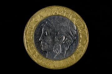 An old coin shot with low-key lighting