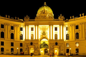 Viennese building cast in yellow light