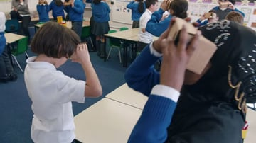 Children viewing Expeditions using Cardboard