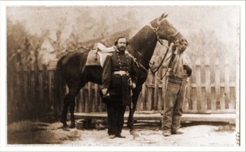 M Miller Colonel 18th Mo Infantry full-length portrait facing right standing before horse held by African-American man Date c 1861