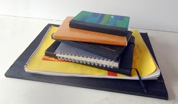 Pile of sketchbooks
