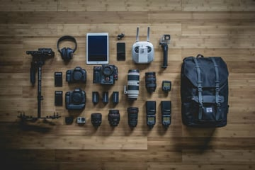 Image of different camera lenses and camera equipment Photo by Unsplash