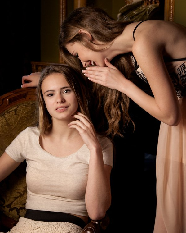 two young women whispering
