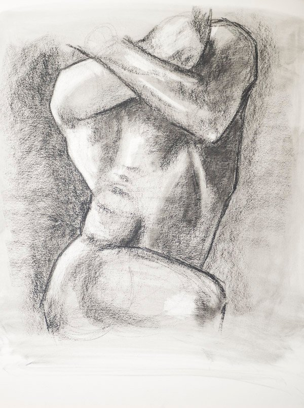 Darkening the deepest shadows of your charcoal sketch