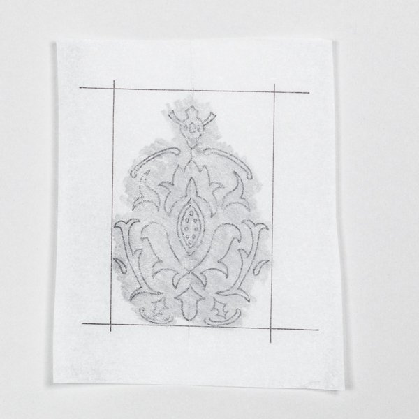 Using your pencil shade the entire back side of your tracing paper