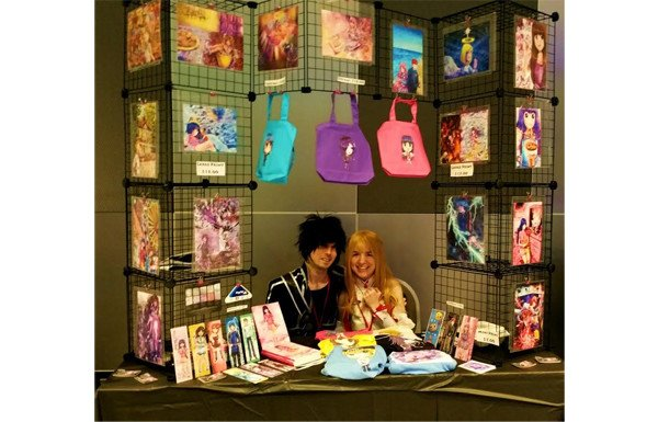 Yennie at her table at a recent convention showing how to use vertical space