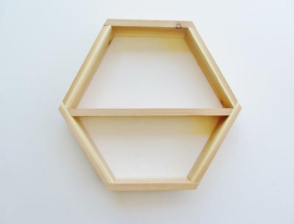 Finished wooden geometric hexagonal shelf